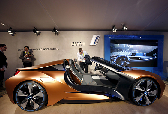 People Look Over The Bmw I Vision Future Interaction Concept Car Includes Airtouch Technology That Lets Driver Control Various Functions